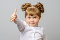 Portrait of cute girl showing thumbs up sign stock photography
