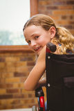 Portrait of cute girl sitting in wheelchair Royalty Free Stock Photos