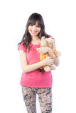 Portrait of cute  girl with a soft toy in the hands isolated on white background Royalty Free Stock Photos