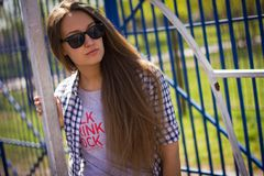 Portrait of a cute girl on the sports ground Stock Images