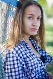 Portrait of a cute girl on the sports ground Royalty Free Stock Photo