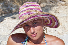 Portrait of cute girl with straw hat Stock Images