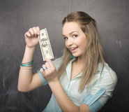 Portrait of cute girl student with money and passport. In classroom Stock Images