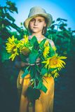 Portrait of cute girl in sunflowers field Stock Photo