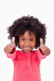Portrait of a cute girl with the thumbs up Royalty Free Stock Images