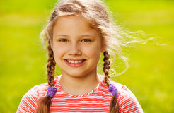 Portrait of cute girl with two braids in summer Royalty Free Stock Photo