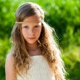 Portrait of cute girl wearing ribbon headband. Royalty Free Stock Images
