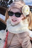 Portrait of cute girl in winter sun Royalty Free Stock Photo