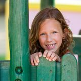 Portrait of cute girl at wooden fence. Stock Photo