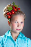 Portrait of cute girl with wreath of tomatoes Stock Photography