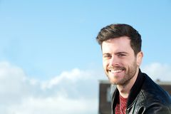 Portrait of a cute guy with beard smiling outside Royalty Free Stock Photo
