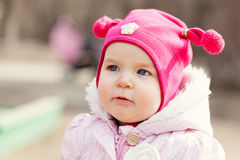 Portrait cute happy baby girl in hat in summer park, Royalty Free Stock Image
