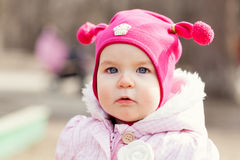 Portrait cute happy baby girl in hat in summer park, Royalty Free Stock Photo