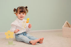 Portrait of cute happy baby girl playing with easter decorations. Close up indoor portrait of cute happy baby girl playing with easter decorations royalty free stock photography