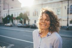 Portrait of cute happy female walking in old european city stock image