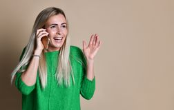 Portrait of a cute happy girl talking on mobile phone and laughing royalty free stock photos