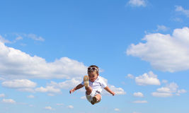 . Portrait of cute happy kid small boy in the sky. Child having fun and enjoying sun in the panorama park. concept of flight. Trampolining Royalty Free Stock Image