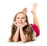 Portrait of a cute happy little girl laying on floor Royalty Free Stock Images