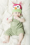 Portrait of cute happy 5 month old baby boy with funny hat. Royalty Free Stock Images