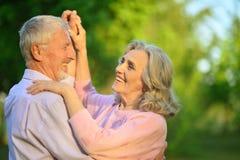 Portrait of cute happy senior couple dancing stock images