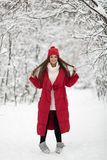 Portrait of cute happy woman outdoor. Winter forest royalty free stock image
