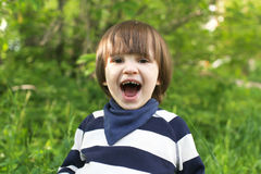 Portrait of cute happy 2 years child outdoors in summer Royalty Free Stock Images