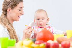 Portrait of a cute and healthy baby girl looking with curiosity Royalty Free Stock Images