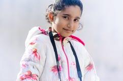 Portrait of Cute Indian Girl wearing Jacket Stock Photo