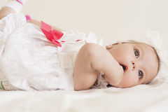 Portrait of Cute Infant Caucasian Female Child. Against White. Stock Photo