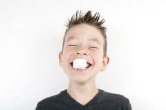 Portrait of cute joyful boy with a marshmallow Stock Photo