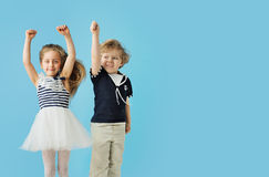 Portrait of cute jumping kids royalty free stock image
