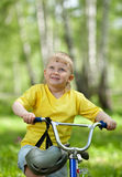Portrait of a cute kid on bicycle Stock Photos