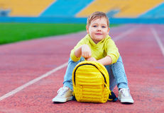 Portrait of cute kid, boy posing in sports wear at the stadium Royalty Free Stock Photography