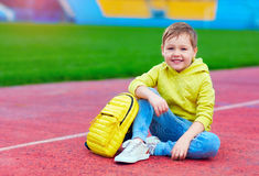 Portrait of cute kid, boy posing in sports wear at the stadium. Portrait of cute kid boy posing in sports wear at the stadium Stock Photos