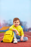 Portrait of cute kid, boy posing in sports wear at the stadium. Portrait of cute kid boy posing in sports wear at the stadium Royalty Free Stock Images