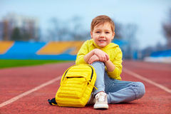 Portrait of cute kid, boy posing in sports wear at the stadium. Portrait of cute kid boy posing in sports wear at the stadium Royalty Free Stock Image