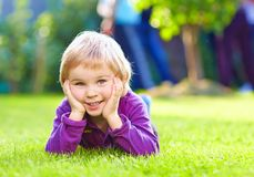 Portrait of cute kid on summer grass Royalty Free Stock Image