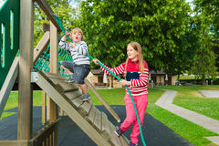 Portrait of a cute kids having fun on playground Stock Image