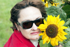 Portrait of cute lady with a sunflower Royalty Free Stock Photography