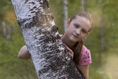 Portrait of cute lass in a forest Royalty Free Stock Photos