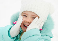Portrait of cute laughing little girl in winter day Royalty Free Stock Images