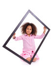 Little african american girl holding a picture frame Royalty Free Stock Images