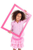 Little african american girl holding a picture frame Royalty Free Stock Image
