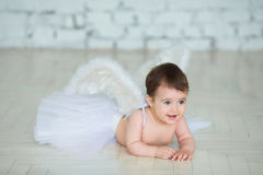 Portrait of cute little baby with angel wings smiling Royalty Free Stock Images