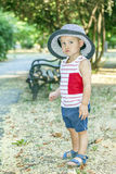 Portrait of a cute little baby boy with a hat. Portrait of a cute little boy with a hat, stands by the river and enjoy the beautiful and sunny day. Baby boy Royalty Free Stock Photography