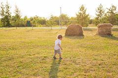 Portrait of cute little baby boy having fun outside. Smiling happy child playing outdoors Stock Image