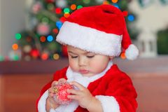 Cute baby boy with Christmas bauble stock photography