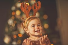 Happy baby on Christmas eve stock images