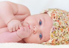 Portrait of cute little baby in colorful hat Stock Image