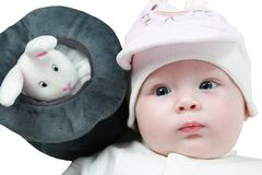 Portrait of cute  little baby girl with blue eyes and toy rabbit Stock Photo